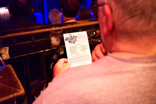 Checking out the schedule at Piano Night - April 29, 2019. Photo by Eli Mergel.