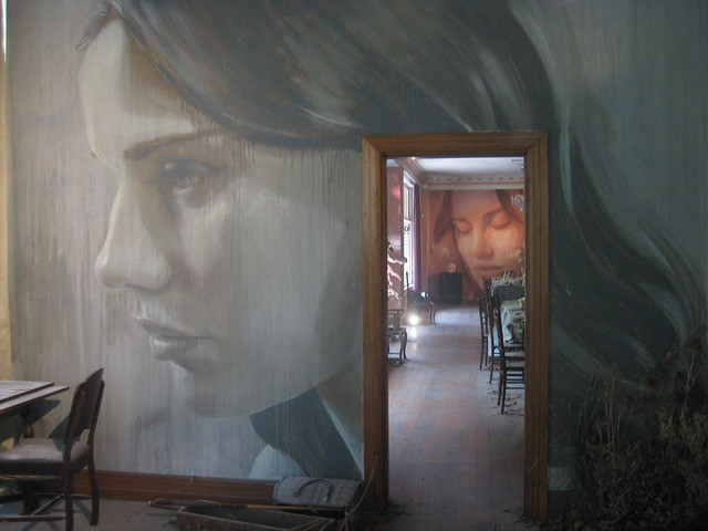 Seeing Double - A View from the Games Room Down the Length of the Dining Room, showing two portraits of Lily Sullivan - Rone Empire Installation Exhibition; Burnham Beeches, Sherbrooke
