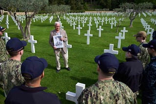 Dwight Anderson commemorates a fallen service member for U.S. Sailors from the John C. Stennis Carrier Strike Group in Draguignan, France.
