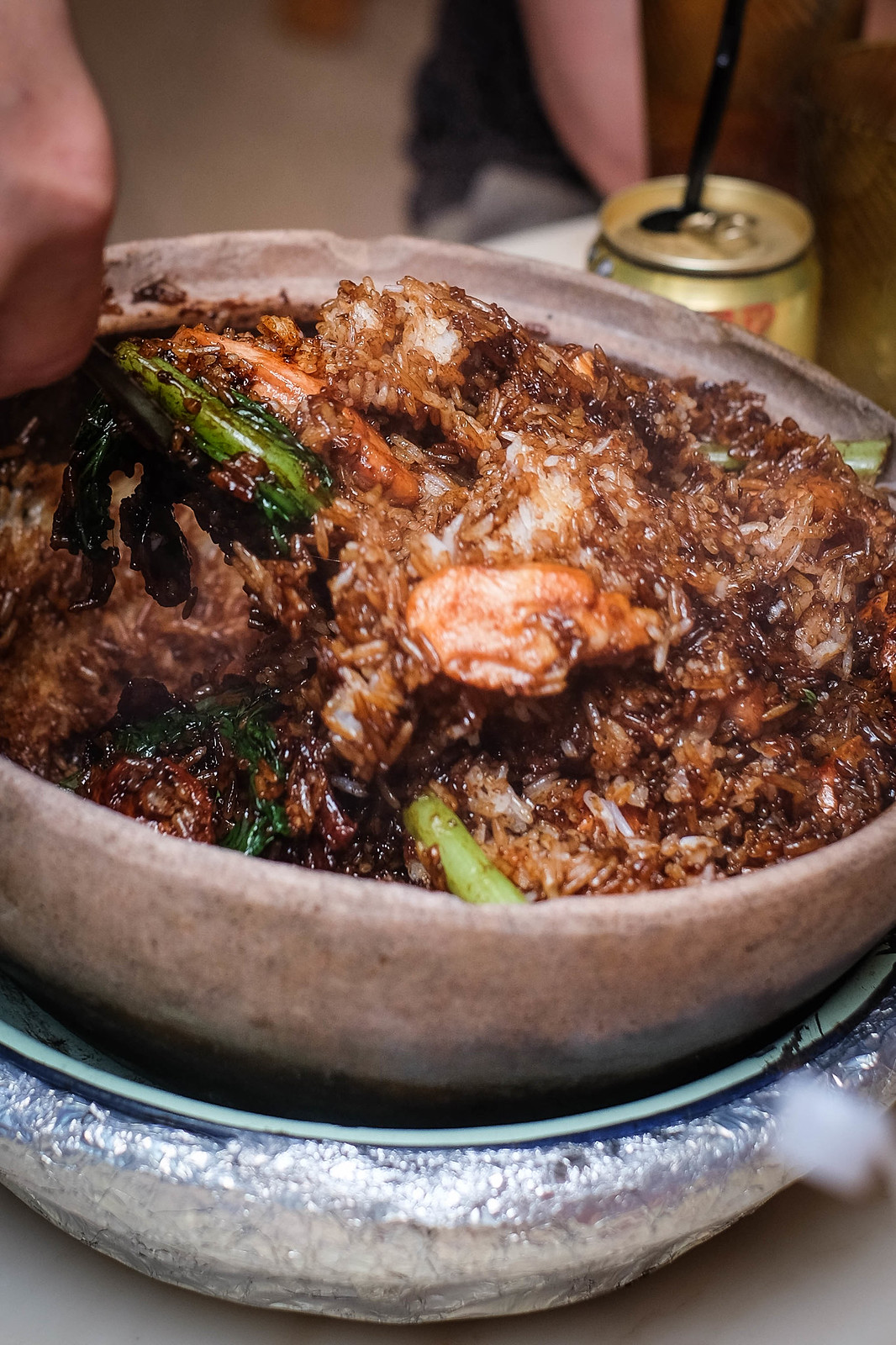 Tossing a portion of claypot rice