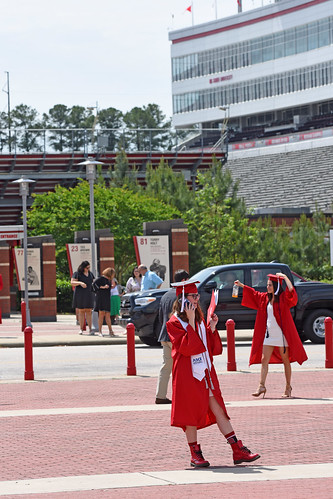 Graduate waits for family to arrive for photos.