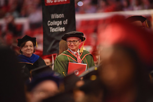 Wilson College of Textiles dean David Hinks passes by his students.