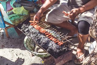 Balinese indonesian street food chicken sate. Preparing chicken sate. Bali island.