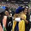 Public health faculty are so proud of the master's degree candidates as they approach the commencement stage at the University of Hawaii at Manoa spring 2019 commencement ceremony on May 11, 2019.