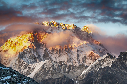 himalayas mountains sunset rocks nepal climbing clouds