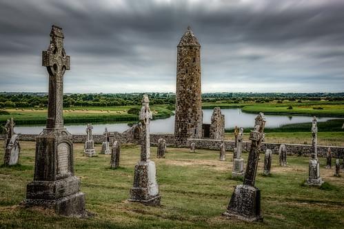 clonmacnoise ireland graveyard cemetery irish celticcross mccarthystower finghin monastery landscape shannon river clouds christianity