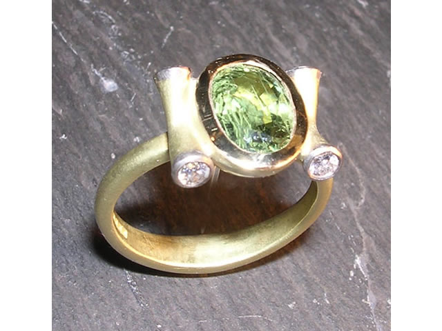 Green Madagascan Sapphire with 18 carat Gold and Diamonds
