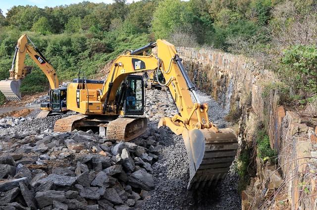 Construction crews working on a dam