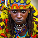 Portrait of a Peul tribe young woman with colorful clothes, Savanes district, Boundiali, Ivory Coast by Eric Lafforgue