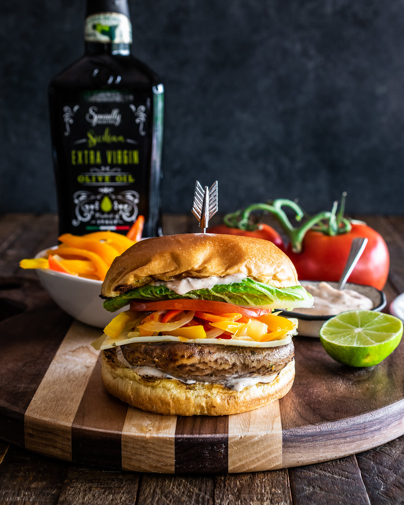 citrus-marinated grilled portobello burgers with sautéed peppers and chipotle mayo