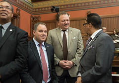 State Representative Tony D'Amelio talks with fellow Waterbury Representative Gerry Reyes during a session day at the state capitol.