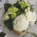 Green and white hydrangea with seeded eucalyptus and spray rose filler. Flowers …