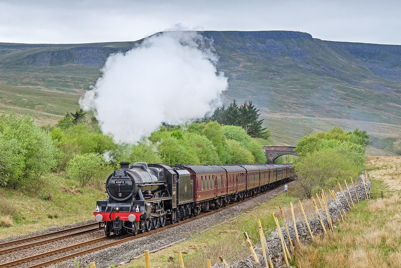 Leander passes Aisgill Summit with the southbound Cumbrian Mountain Express of May 18th 2019. Wild Boar Fell looms in the background.
