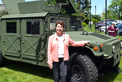 "State Rep. Livvy Floren (R-Greenwich, Stamford) by a green military humvee after donating t""Help-a-Hero,"" which benefits homeless veterans."