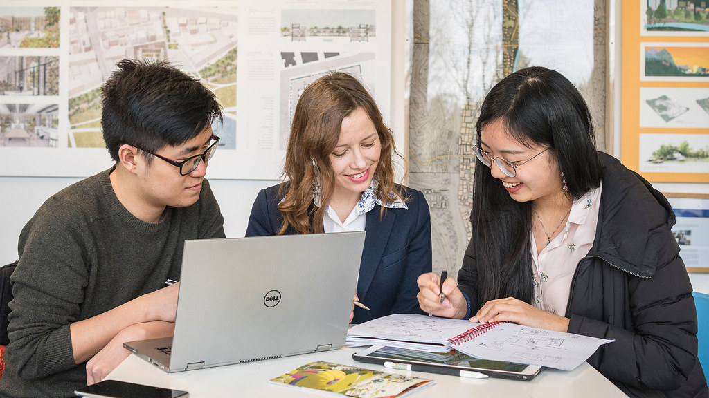Three students work on MSc project in architecture studio