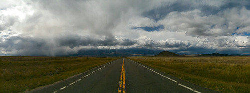 foothills endlessroad hills road storm highway straightroad yellowstripe mountains oldroad clouds roadtonowhere panorama countryroad fence silvercliff colorado unitedstates us