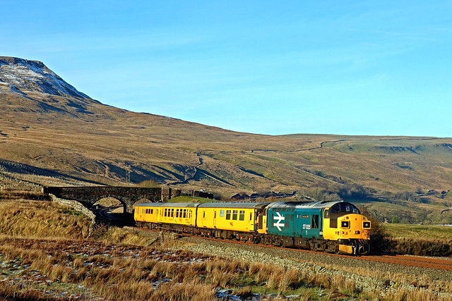 37025 'Inverness TMD' reaches the summit of Ais Gill on S and C Line on 24.1.19 pushing 3Z72  0950 Derby R.T.C.(Network Rail) to Carlisle short test train. DBSO 9701 leads northwards