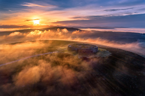 grianan aileach lough swilly foyle ancient irish kings hill lookout fort sunrise misty mist fog fogy dew cloudy clouds ring ringed burt county donegal ireland summer landmark stone monument tourist site famous visit scenic countryside druid celtic gareth wray photography inishowen derry londonderry an angrainan sun inch island historic aerial drone dji phantom p4p pro quadcopter heather national gaelic photographer garethwrayphotography vacation holiday europe sunset kingdom architecture landscape 4 sky graianan