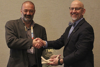 Ricardo Lebensohn (left) receiving the award from Dan Miracle, chief scientist of the Air Force Office of Scientific Research and chairman of TMS Structural Materials Division.