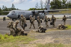 Soldiers exit a C-130 Hercules aircraft and secure the airfield as Exercise Palau kicks off