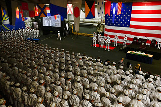 Sailors stand at parade rest during a CoC ceremony aboard the amphibious assault ship USS Wasp | by #PACOM