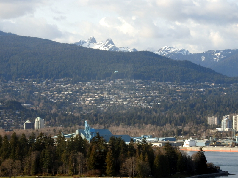 THE LIONS AND STANLEY PARK,  LOOKING TO WEST VANCOUVER,  AS SEEN FROM VIEW FROM THE WATERFRONT HOTEL, VANCOUVER,  BC.