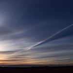 11. Aprill 2019 - 18:24 - Sundog, flares and colours with contrail. Another beautiful sunset silhouette.  Thank you for viewing everyone.