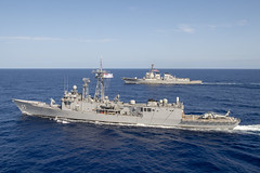 PHILIPPINE SEA (April 18, 2019) The Arleigh Burke-class guided-missile destroyer USS Preble (DDG 88) and the Royal Australian Navy Adelaide-class guided-missile frigate HMAS Melbourne (FFG 05) transit in formation during a cooperative deployment. Preble and Melbourne are participating in a cooperative deployment in order to improve on maritime capabilities between partners.  Preble is deployed to the U.S 7th Fleet area of operations in support of security and stability in the Indo-Pacific region. (U.S. Navy photo by Mass Communication Specialist 1st Class Bryan Niegel/Released)