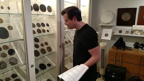 Medialia Steve Roach examining exhibit
