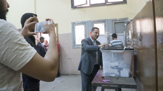 Casting a vote in front of a mobile phone camera