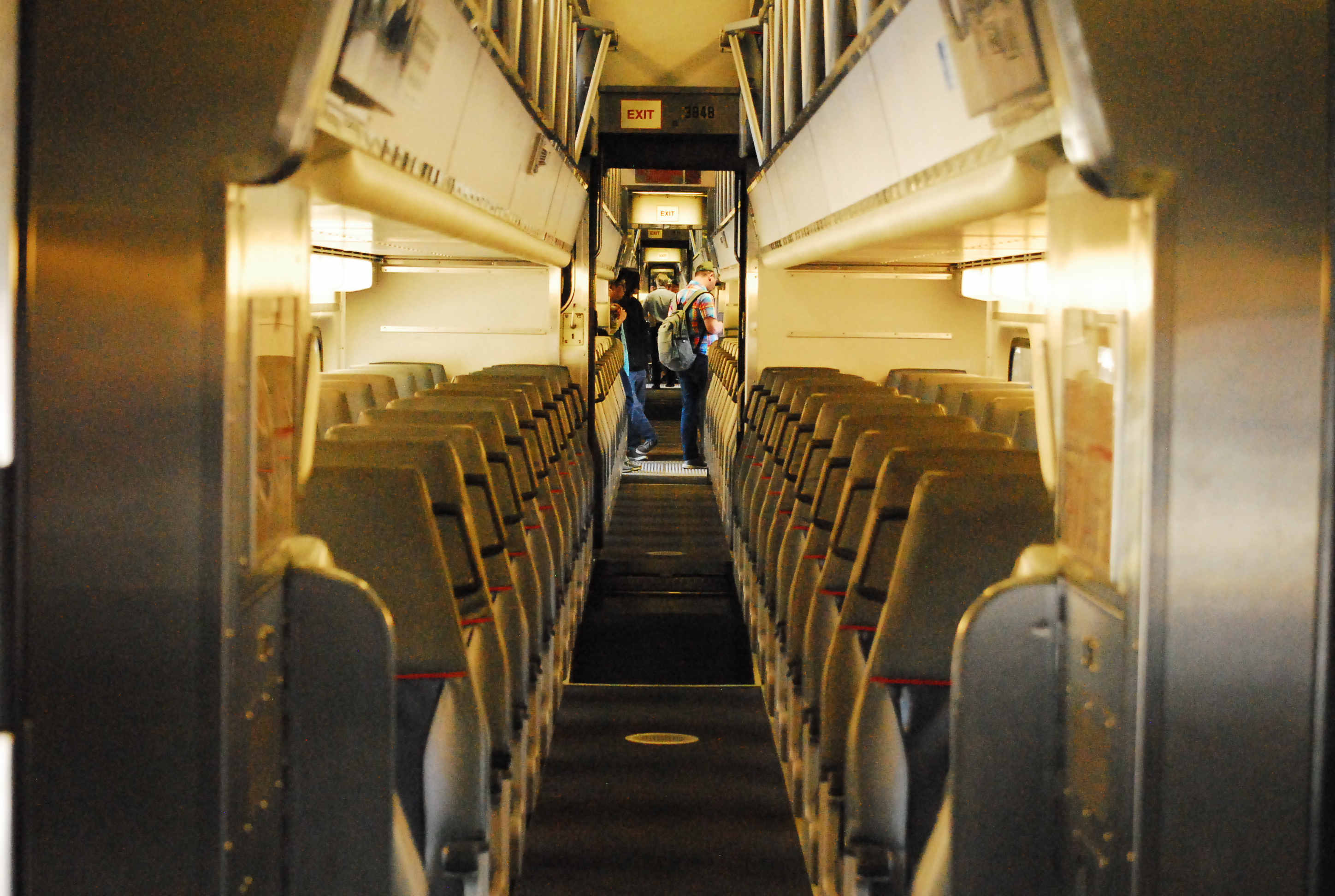 An interior shot of the lower floor of a Nippon Sharyo passenger car