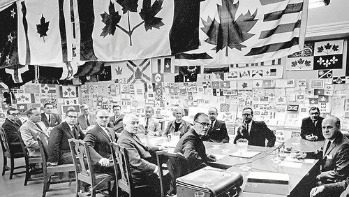 The committee of fifteen MPs assembled to decide on a flag for Canada in 1964, shown in Design Canada.
