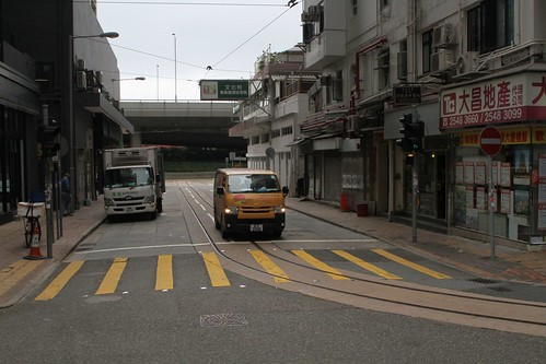 Single track along Chiu Kwong Street from the Whitty Street depot rejoins from rejoins Des Voeux Road West