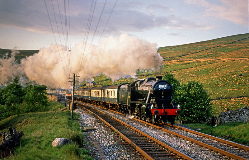 Not the best of slides and I am not sure of the date on this one, possibly June 1988. 8F 48151 races awards the north portal of Blea Moor tunnel with the last of the days summer sun just catching the sides.