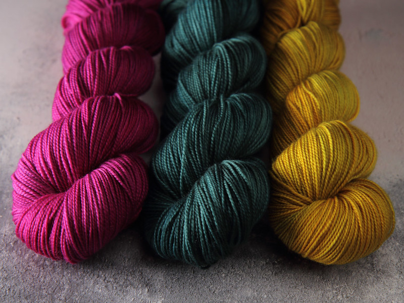 Hand dyed yarn skeins in semi-solid colours