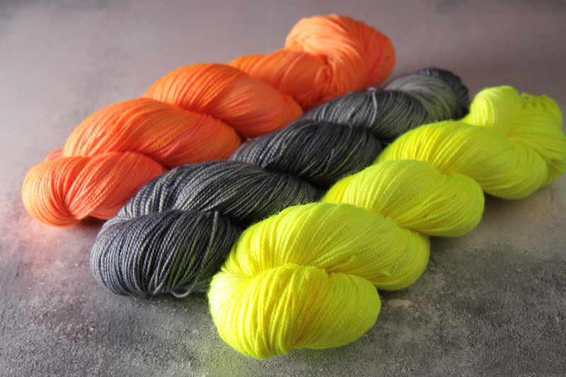 Neon and grey hand dyed yarn skeins