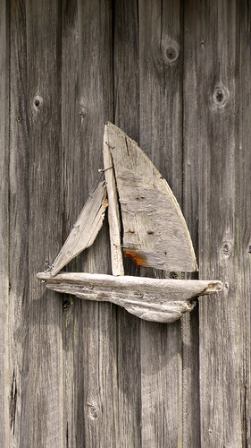 A wooden boat decorates a boathouse in Gronemad, Sweden