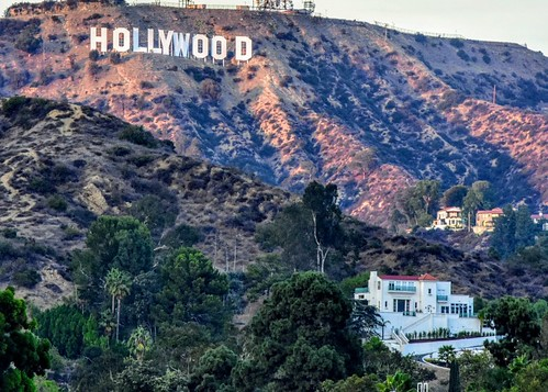 Up in the Hollywood Hills, the Hollywood Sign along with one of its oldest homes.