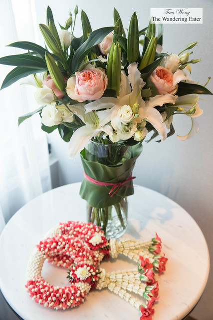 Phuang malai and an elegant bouquet of roses and lilies
