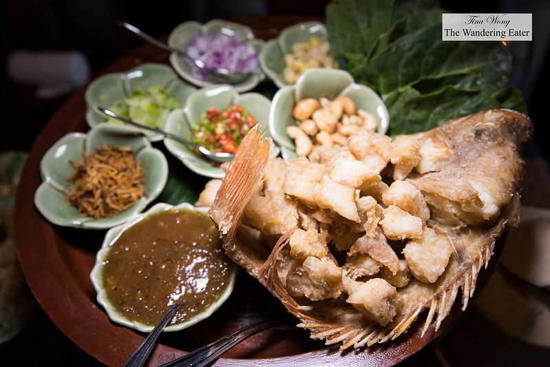 Mieang PlaTub Tim เมี่ยงปลาทับทิม - Fried red tilapia served with kale leaves and Thai toppings and sauce