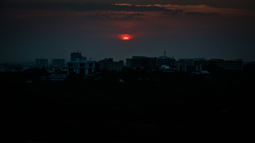 bangalore karnataka india sunset over cubbon park viewed from jw marriott hotel bengaluru indian sun orange clouds cloud