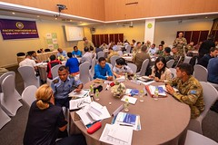 Participants from Timor-Leste, Australia, Japan and the United States participate in a group discussion during a humanitarian assistance and disaster relief workshop, April 29. (U.S. Navy/MC2 Nicholas Burgains)