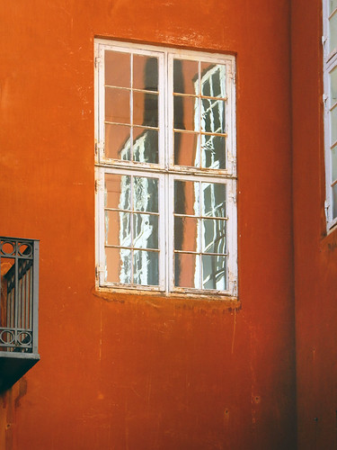 Window in an orange wall wall in Copenhagen, Denmark