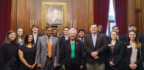 Alt text: Alabama Gov. Kay Ivey and Auburn students