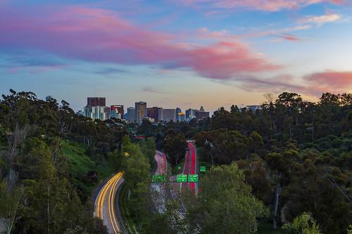 sandiego california unitedstatesofamerica balboapark 163 highway freeway traffic skyline city pastel
