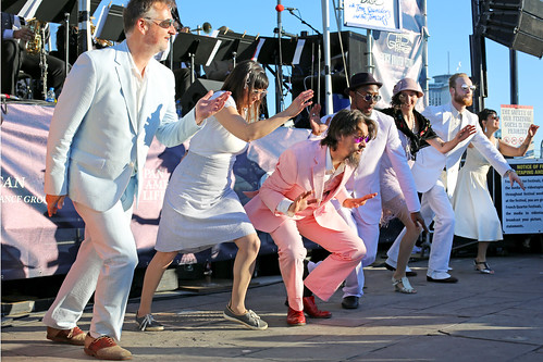 Dancing at dusk with Tom Saunders & the Tomcats at French Quarter Fest - 4.14.19. Photo by Bill Sasser.