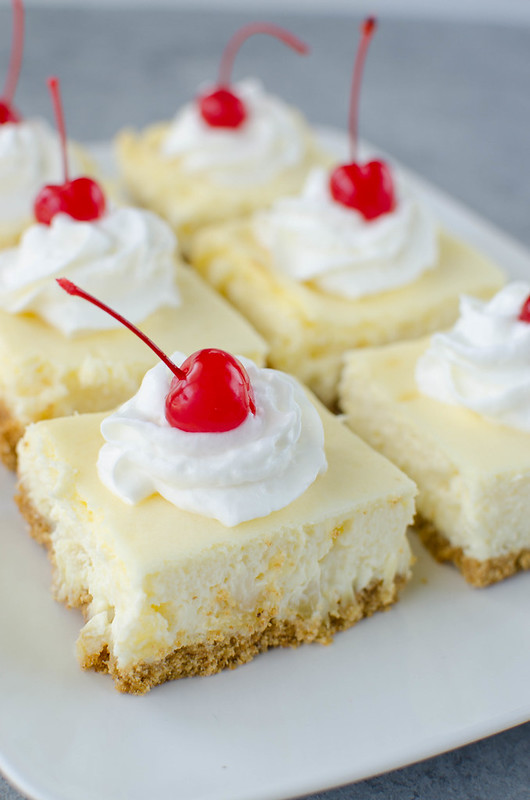 Pineapple Cheesecake Bars - creamy cheesecake filled with pineapple on a graham cracker crust. An easy recipe that comes out perfect every time!