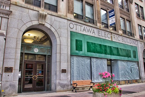 ottawa ontario on canada sparks street mall village uptown tourist travel attraction site store front green dragon leather goods flower planters bench architecture style italianate reflection light fixture retail stores sky clouds onasill canon rebel sl1 18250mm sigma macro spark st plaza sunset road outdoor building ottawaelectric 1926 historic heritage 56spark