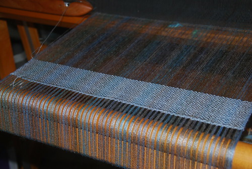 Weaving 3-shaft point twill on Schacht Mighty Wolf loom with handspun merino/tencel warp using Bluster Bay end feed shuttle by irieknit