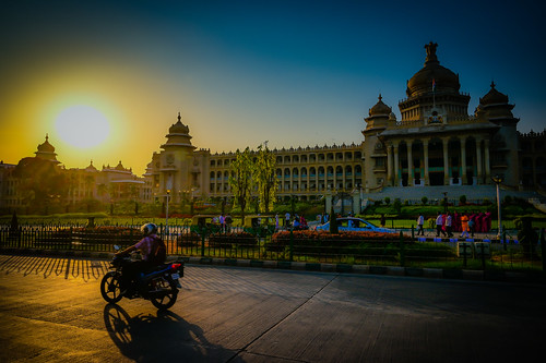 bangalore karnataka india vidhana soudha sunset government capital capitol state assembly legislature building dome yellow sun blue orange afternoon late bengaluru